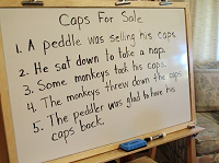 ホワイトボードにCaps for Saleの英語
