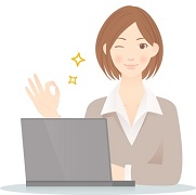 A woman showing OK gesture by a laptop